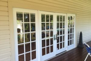 four part patio door before Manchester Lakes clubhouse
