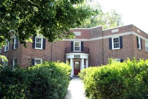 Historic brick business entryway with windows and doors completed by Acadia Windows & Doors.